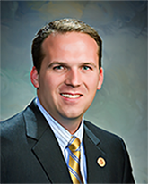 Justin olson commissioner